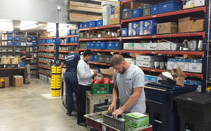 Men in a stockroom with supplies